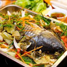 Cách nấu cá chép om dưa chua thanh, đậm đà